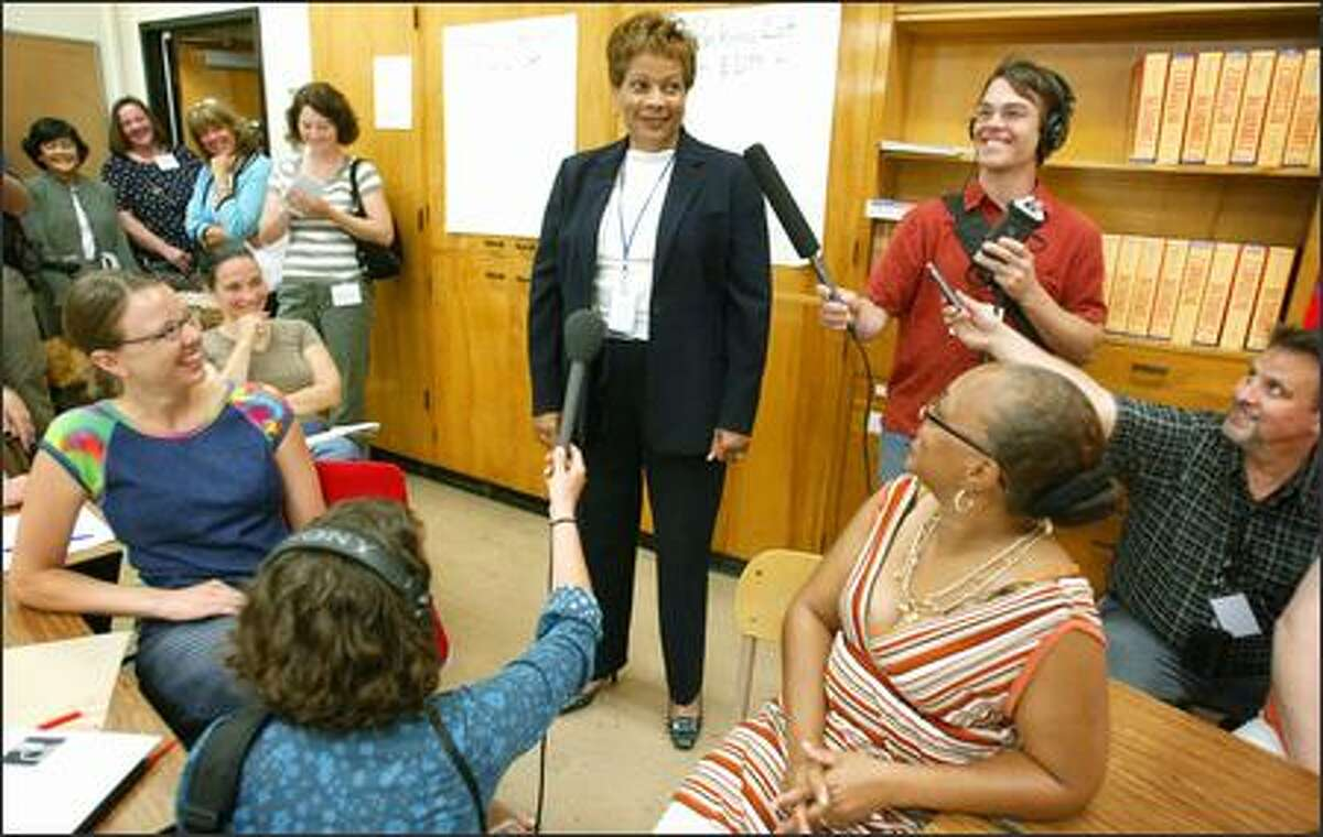 Teachers at Northgate Elementary enjoy a laugh Monday with Maria Goodloe-Johnson, new superintendent of Seattle Public Schools. A former educator and school superintendent in Charleston, S.C., Goodloe-Johnson spent her first day on the job touring several schools with reporters in tow.