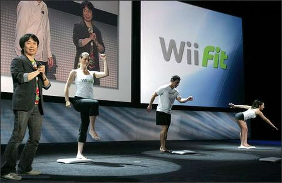 Nintendo game designer Shigeru Miyamoto, left, introduces the new Wii Balance Board during E3 in Santa Monica, Calif. Photo: / Associated Press