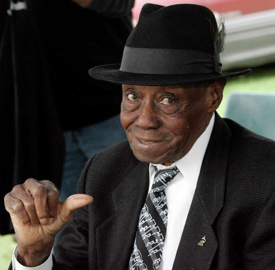 """FILE - In this Oct. 11, 2009 file photo, Grammy winning blues pianist Joe Willie """"Pinetop"""" Perkins motions a """"thumbs up"""" gesture during the annual festival at Hopson Plantation in Clarksdale, Miss. Perkins, one of the last old-school bluesmen and oldest Grammy winner, died at his home of cardiac arrest Monday, March 21, 2011, his manager said. He was 97. (AP Photo/Rogelio V. Solis, File) Photo: Rogelio V. Solis"""