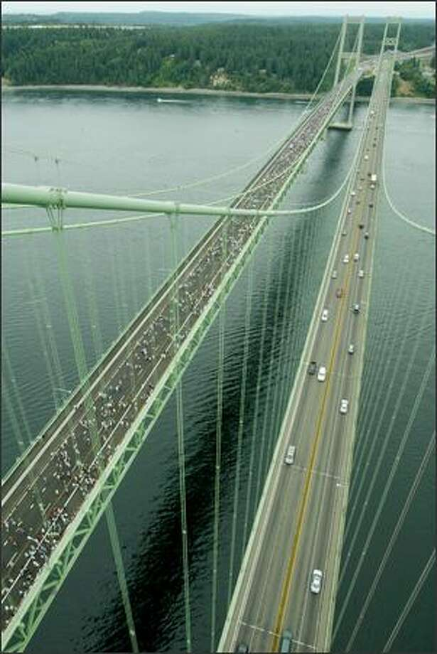 The new Tacoma Narrows Bridge, as seen from the top of the south tower of the old bridge. Photo: Paul Joseph Brown/Seattle Post-Intelligencer