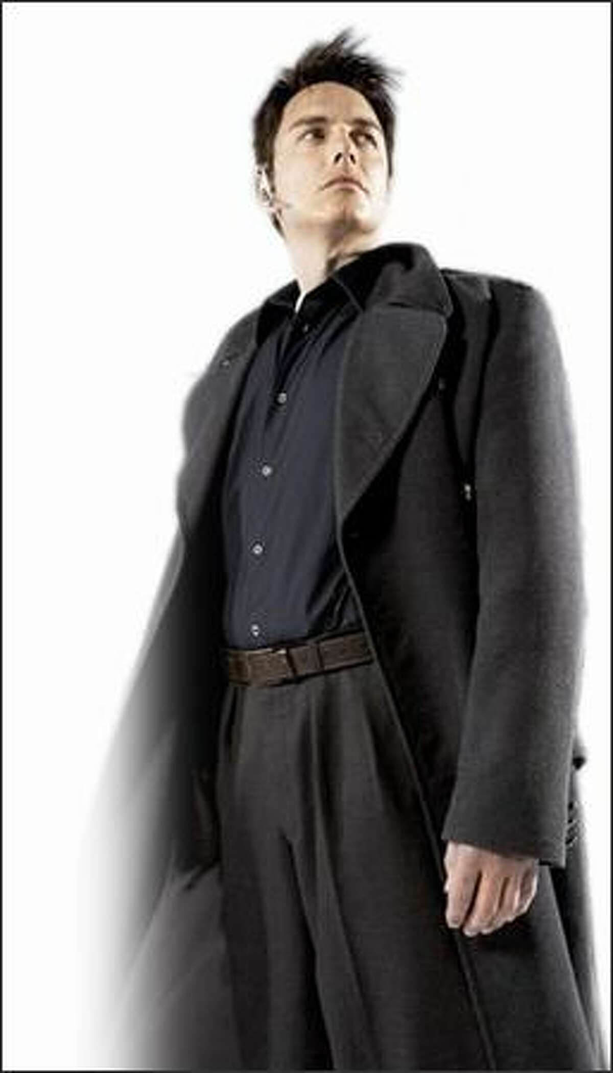 """Captain Jack Harkness (John Barrowman) stands tall on """"Torchwood,"""" a """"Doctor Who"""" spinoff."""