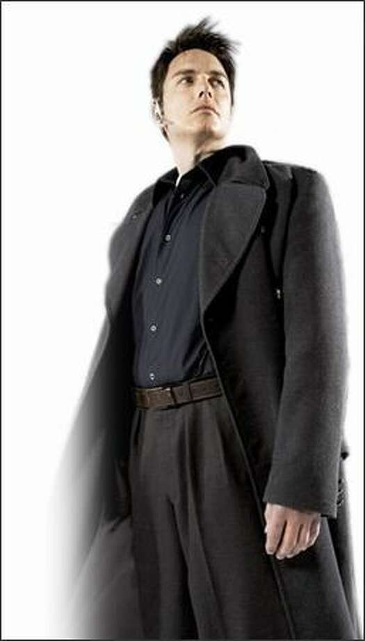 """Captain Jack Harkness (John Barrowman) stands tall on """"Torchwood,"""" a """"Doctor Who"""" spinoff. Photo: BBC"""