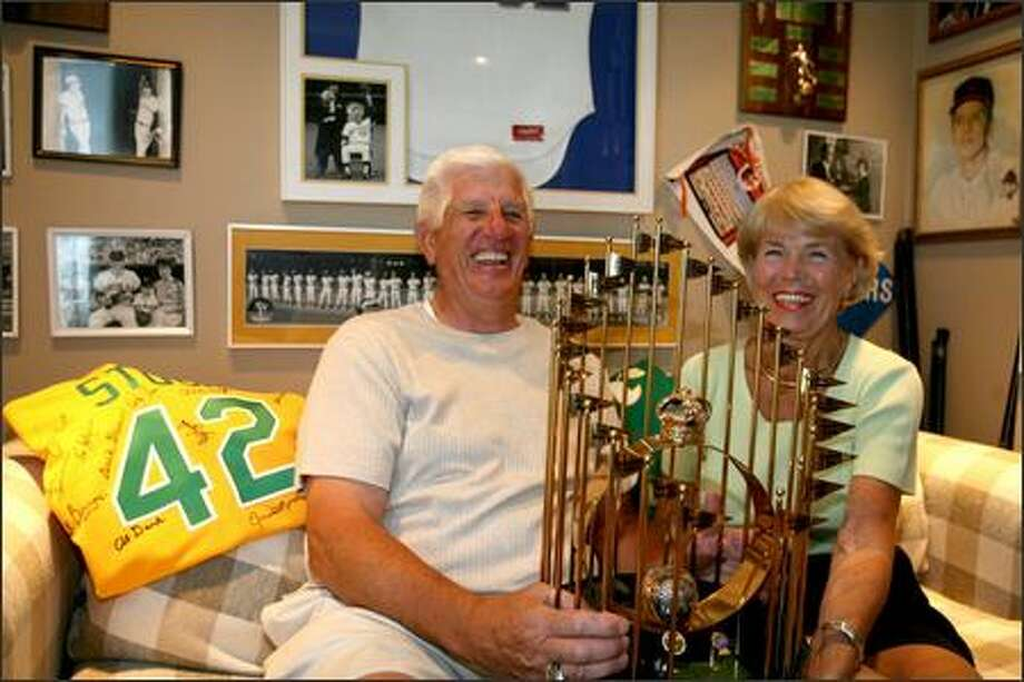 NOW: Wes Stock, 73, at home with his wife, Bev, on Treasure Island in south Puget Sound near Allyn, holds a World Series trophy he earned in 1973 as pitching coach of the Oakland A's during his 38 seasons in professional baseball. Photo: Scott Eklund/Seattle Post-Intelligencer