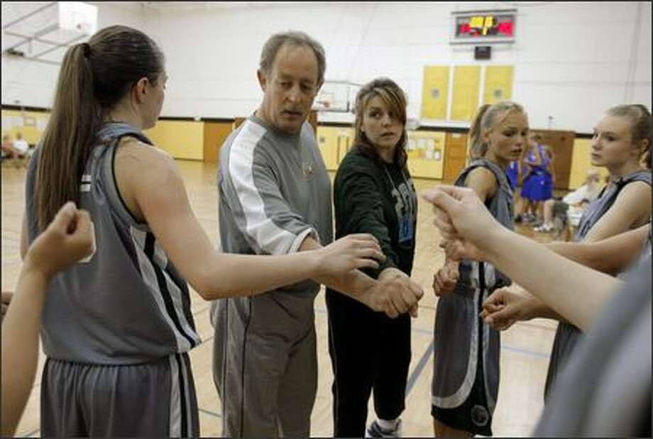 Chuck and Elena Stowell, center, coach the Emerald City Legends, the 15-and-under team their daughter Carly played on. Carly, 14, collapsed and died in April. The Stowells took over the team after the Legends coach took another job. Photo: Gilbert W. Arias/Seattle Post-Intelligencer