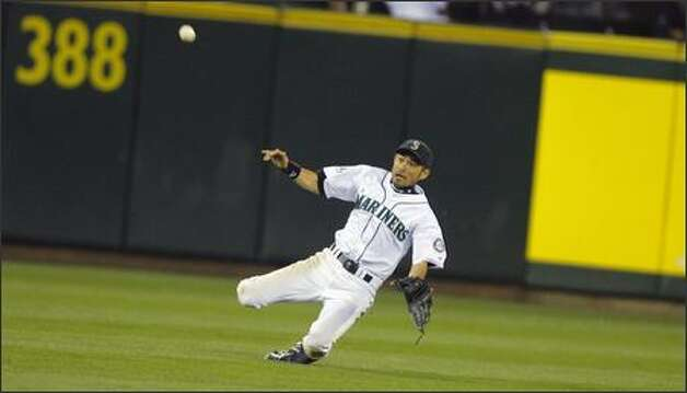 Ichiro Suzuki stumbles as he races towards a ball hit by Jay Gibbons in the seventh inning. Photo: Gilbert W. Arias/Seattle Post-Intelligencer