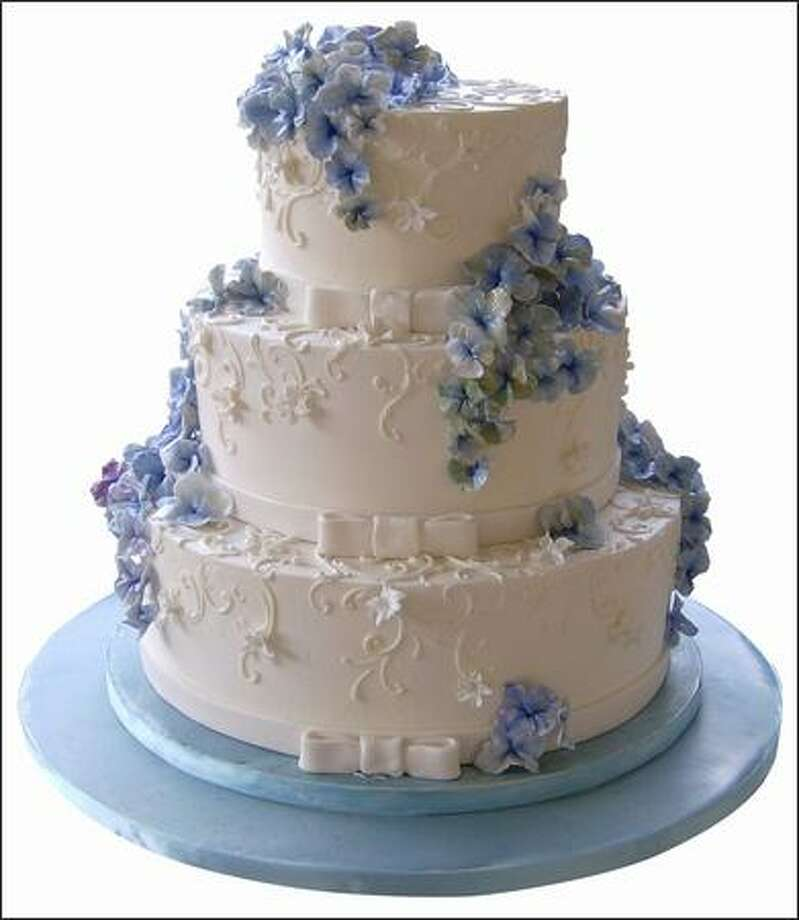 Aimee Page of Hollyhock Cakes created this organic work of art with sugar hydrangeas. Photo: /