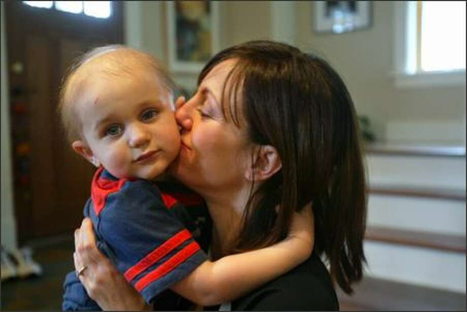 Keaton Wrenn, 2 1/2, gets a snuggly kiss from his mother, Lisa Owen Wrenn, at their home in Seattle. CaringBridge.org lets Wrenn share news about Keaton's health. Photo: Andy Rogers/Seattle Post-Intelligencer