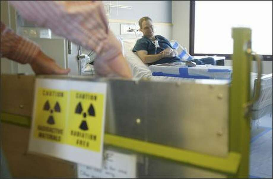 A warning is placed at the lead barrier to Rep. Ross Hunter's room at the UW Medical Center, where his treatment left him highly radioactive. Photo: Andy Rogers/Seattle Post-Intelligencer