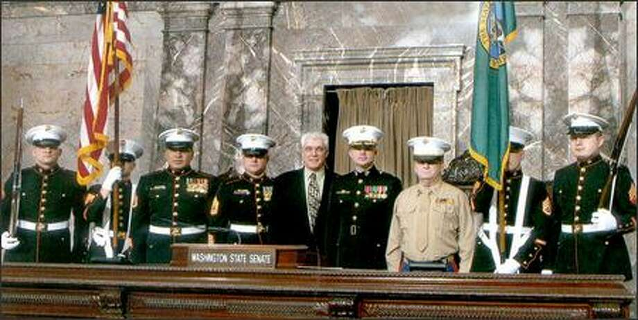 Reggie L. Buddle of Puyallup, standing in the khaki shirt, during the 2006 opening ceremony for the Washington State Senate. (Photo provided by U.S. Attorney's office) Photo: /