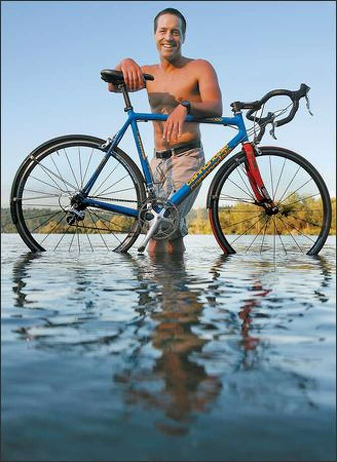 """Bob Heyer, dipping his """"rain bike"""" in Lake Sammamish in front of his home, was diagnosed with diabetes when he was 15. Photo: Mike Urban/Seattle Post-Intelligencer"""