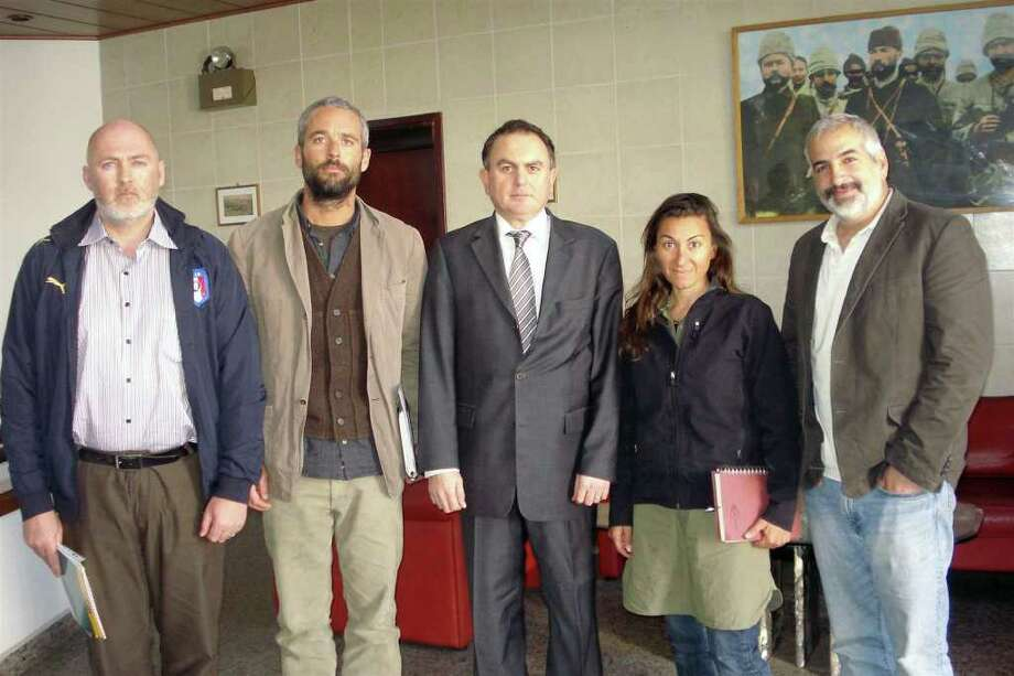 In this March 21, 2011 photo released by the  Turkish Ministry of Foreign Affairs, from left to right, New York Times journalists Stephen Farrell, Tyler Hicks, Ambassdor Levent Sahinkaya, Lynsey Addario and Anthony Shadid pose at the Turkish Embassy in Tripoli, Libya. The four New York Times journalists who had been held by Libya crossed into Tunisia on Monday after being released. (AP Photo/Turkish Ministry of Foreign Affairs) Photo: Anonymous, ASSOCIATED PRESS / AP2011