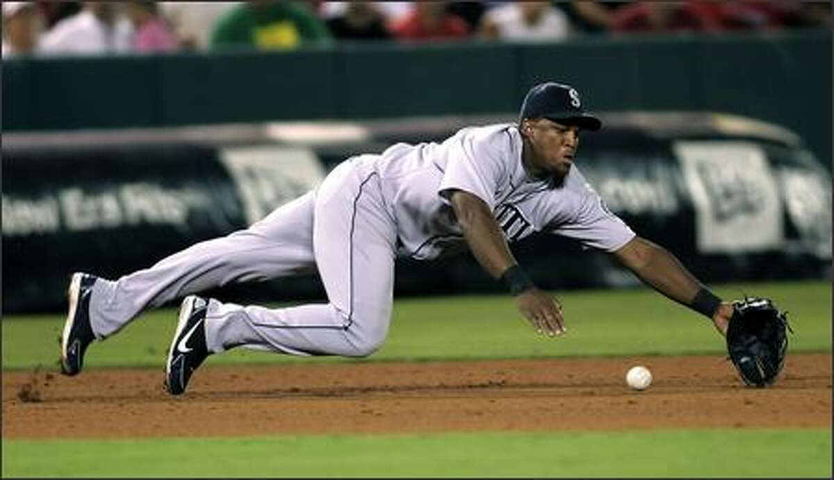 Seattle Mariners third baseman Adrian Beltre dives for an infield single hit by Los Angeles Angels' Robb Quinlan in 2006.