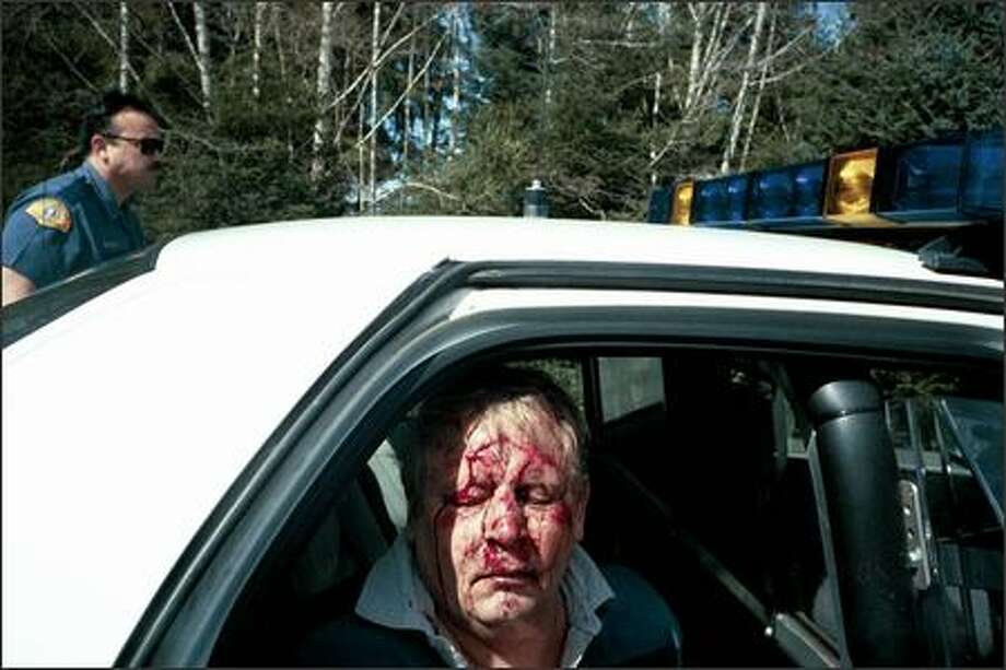 Michael Bowe, a Thurston County sheriff's deputy, was stopped in March 2004 in Grays Harbor County for a DUI arrest -- one of five such stops while he carried a badge. How his face was bloodied was never determined, but his service weapon was in the car. Read his story. Photo: / Washington State Patrol