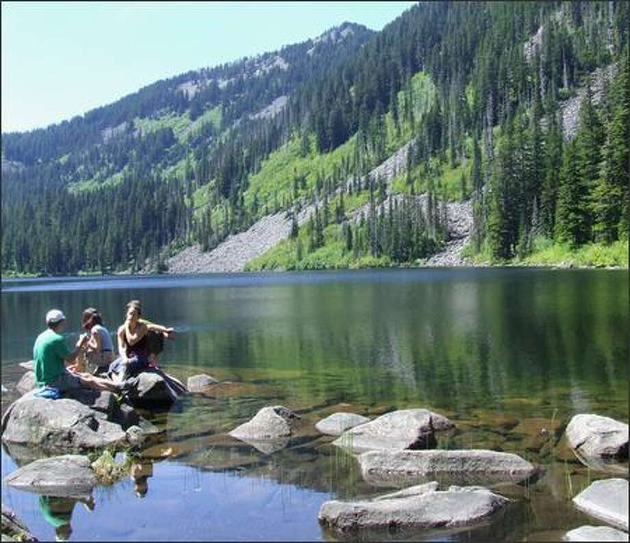 Reaching Pratt Lake at 3,400 feet is a good opportunity for hikers to take a break, explore or cool their feet before continuing on one of many more trails. Photo: Karen Sykes/Special To The Post-Intelligencer