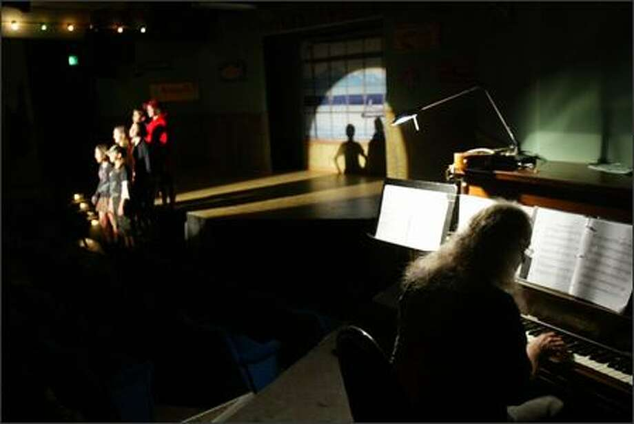 "Musician John Engerman plays the piano during the musical about life at Pike Place Market, ""The North Arcade,"" now playing at the Market Theater in Post Alley. Photo: Karen Ducey/Seattle Post-Intelligencer"