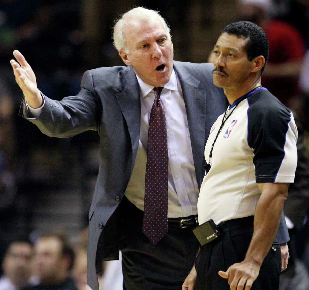 FOR SPORTS - Spurs' head coach Gregg Popovich looks for a call from official Bill Kennedy during second half action against the Warriors Monday March 21, 2011 at the AT&T Center. The Spurs won 111-96. (PHOTO BY EDWARD A. ORNELAS/eaornelas@express-news.net)