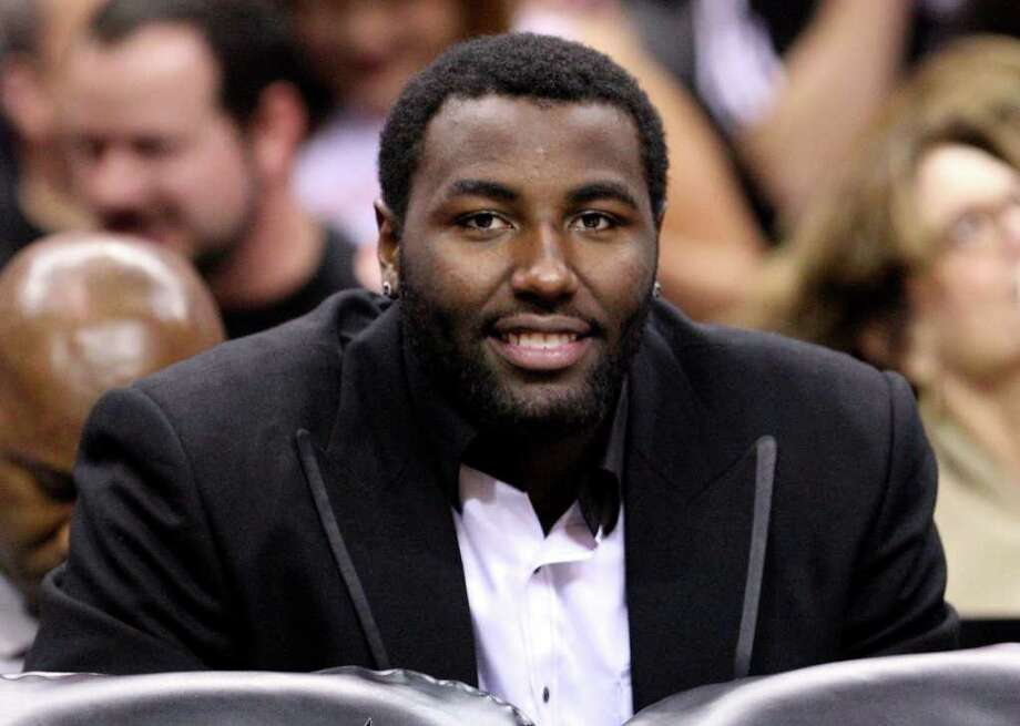 FOR SPORTS - Spurs' DeJuan Blair sits on the bench during first half action against the Warriors Monday March 21, 2011 at the AT&T Center.  (PHOTO BY EDWARD A. ORNELAS/eaornelas@express-news.net) / SAN ANTONIO EXPRESS-NEWS NFS