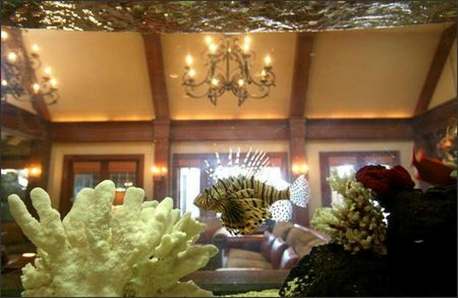 A tropical fish floats in the large tank that borders the family room of a Mercer Island mansion listed at $34.5 million. Photo: Scott Eklund/Seattle Post-Intelligencer