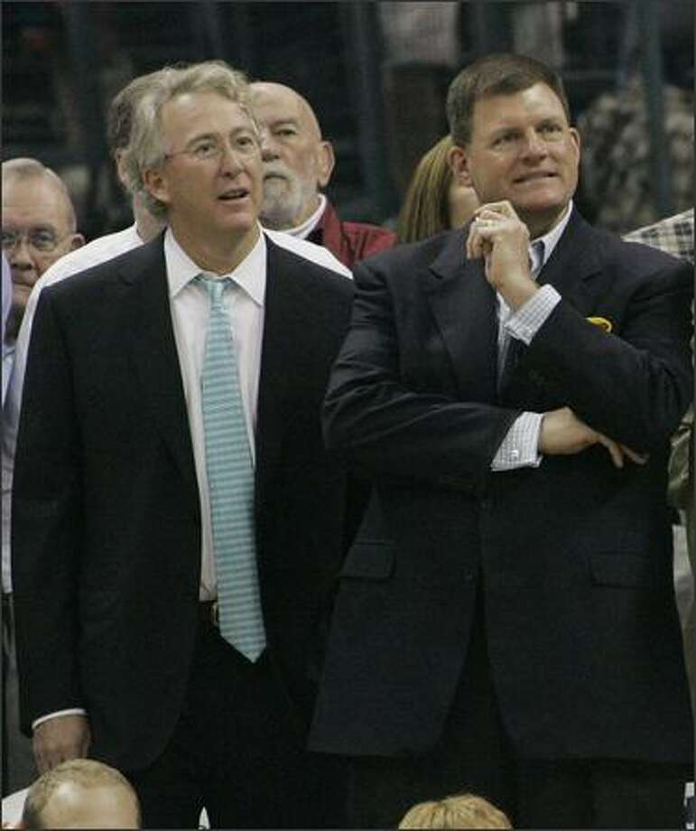 Sonics owner Clayton Bennett, right, with Oklahoma City businessman and team minority owner Aubrey McClendon, has said repeatedly that he prefers to keep the team in Seattle. Photo: / Associated Press