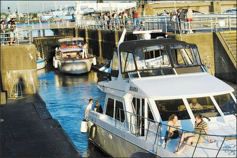 Pleasure boat Bidarka exits the locks and heads out to Puget Sound. Photo: KAREN DUCEY/P-I
