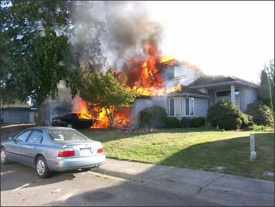 The residential fire in the 26100 block of 131 Pl. SE. in Kent is shown in this photo provided by the Kent and King County Fire District 40. Photo: /