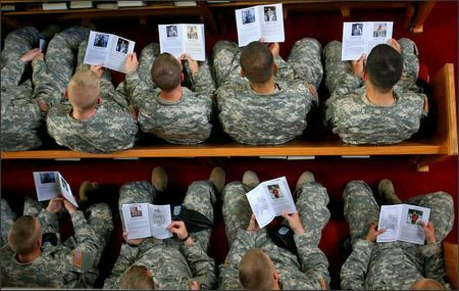 Soldiers in the 2nd Battalion, 3rd Infantry Regiment sit in the pews at the Fort Lewis Main Post Chapel during a service Wednesday for six fellow soldiers killed in Iraq. Photo: Scott Eklund/Seattle Post-Intelligencer