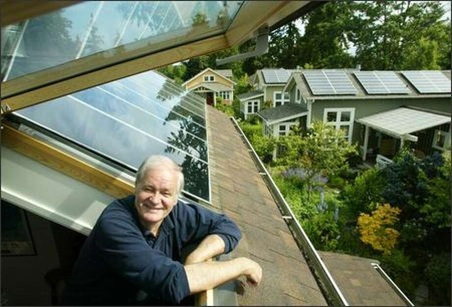 Mike Nelson's home in Shoreline is powered by solar arrays on the roof, accessed by a skylight. Two of his neighbors recently installed solar energy systems as well. His home uses just 3.5 kilowatt-hours a day; the Seattle average is 30. Photo: Paul Joseph Brown/Seattle Post-Intelligencer