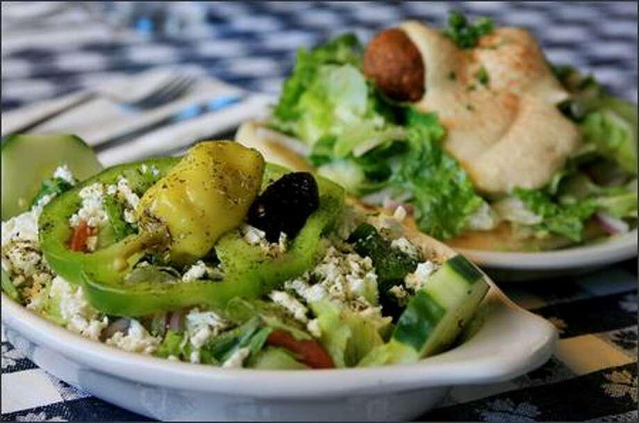 A Greek side salad with a falafel sandwich at West Seattle's flavorful and friendly Kokoras Greek Grill. Photo: Dan DeLong/Seattle Post-Intelligencer