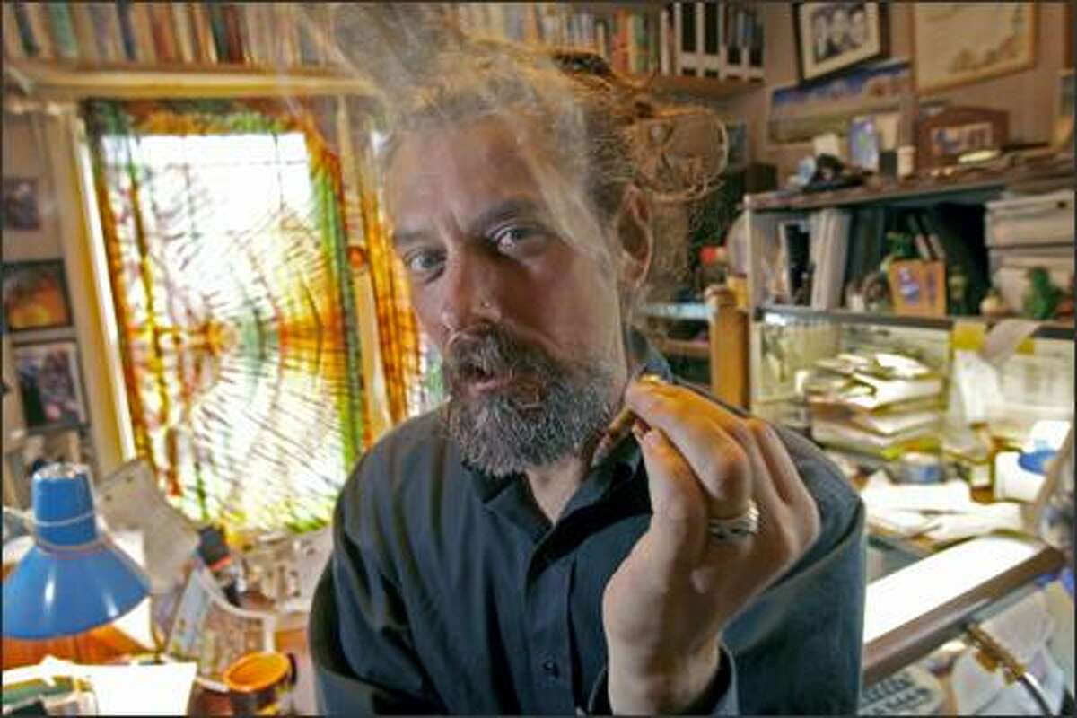 Vivian McPeak, who co-founded Hempfest in 1991 to promote marijuana legal reform, uses medical marijuana in his home office before visiting a doctor in Edmonds.