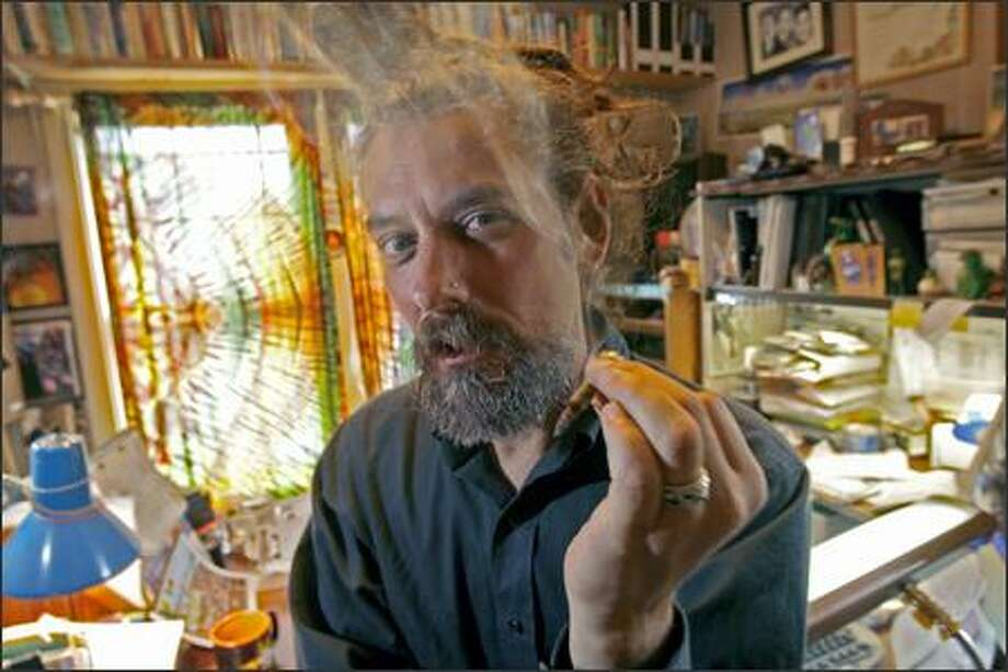 Vivian McPeak, who co-founded Hempfest in 1991 to promote marijuana legal reform, uses medical marijuana in his home office before visiting a doctor in Edmonds. Photo: Grant M. Haller/Seattle Post-Intelligencer