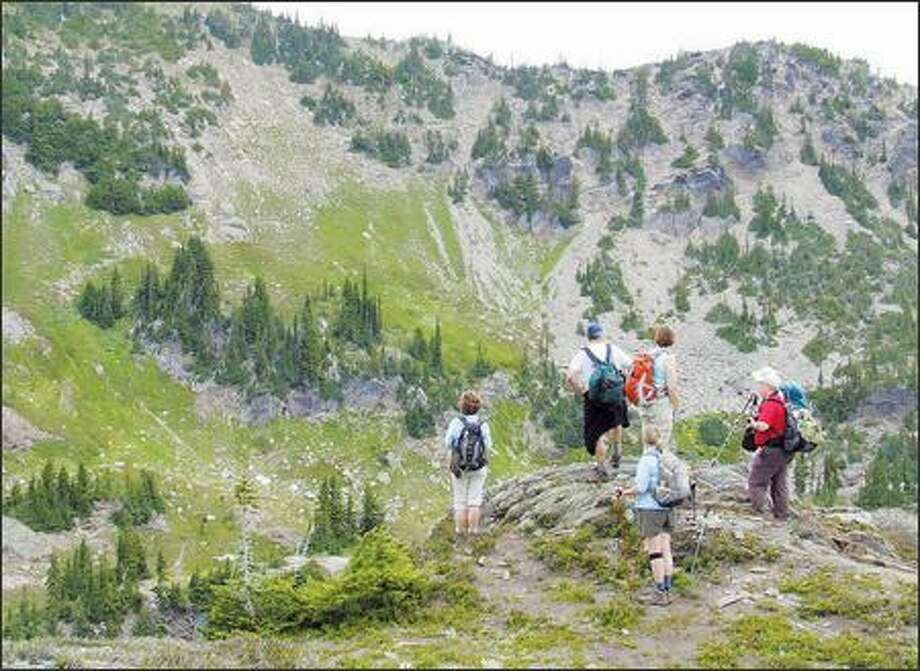 On a cool, cloudy day, a Mountaineers group begins the climb from the Nason Ridge Trail junction toward Rock Mountain. Photo: KAREN SYKES