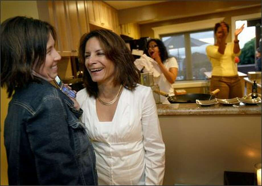 Seattle City Council candidate Venus Velazquez, center, listens to the first election returns Tuesday night with campaign manager Joanne Matsusaka, left, at a campaign party in West Seattle. She will face Bruce Harrell, a business and employment lawyer, in November in the only election campaign for an open seat on the City Council. Photo: Joshua Trujillo/Seattle Post-Intelligencer
