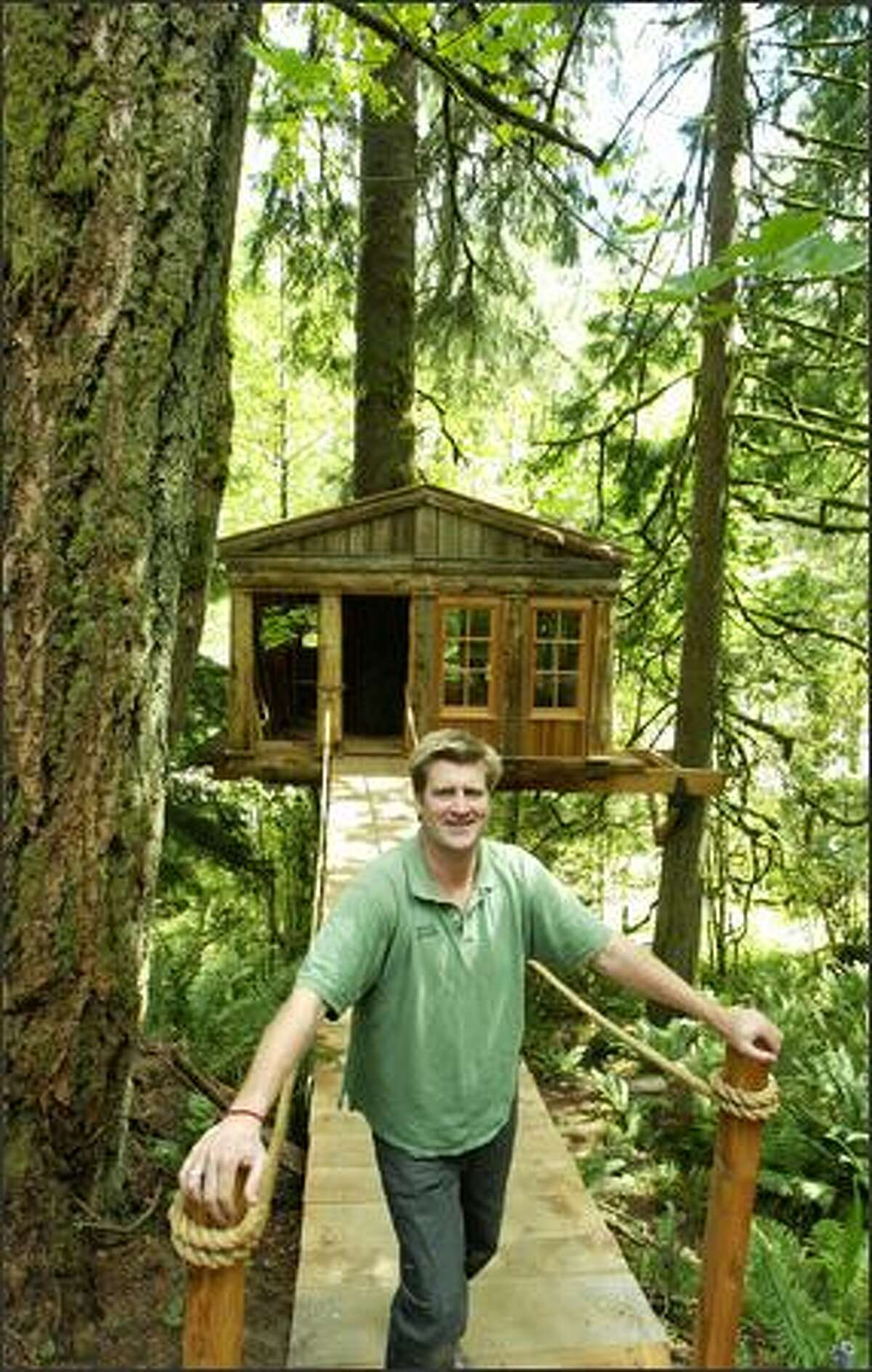 TreeHouse Workshop co-owner Pete Nelson stands in front of one of the treehouses built by participants in his workshop.