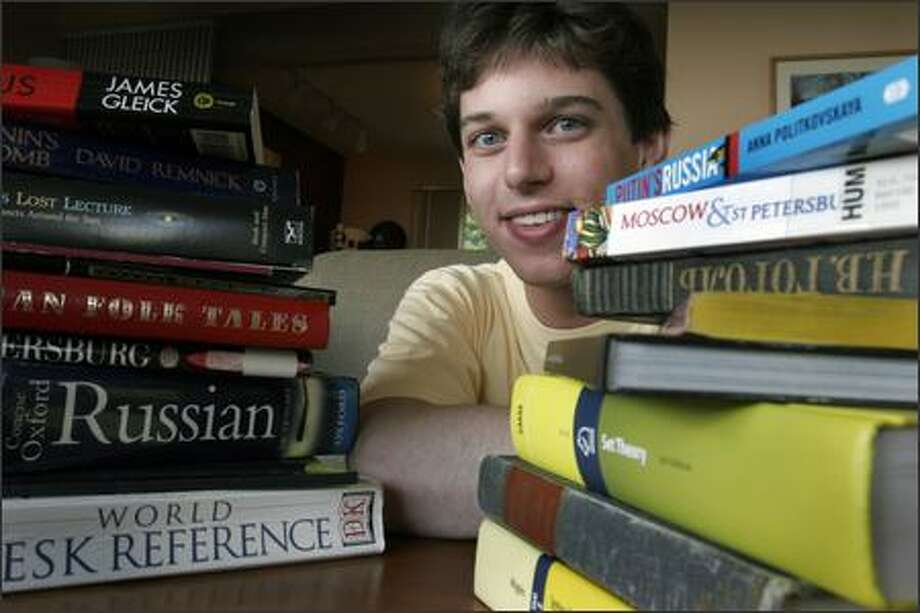 "UW junior Nate Bottman, 17, received a $25,000 Davidson award. Along with math, he is studying Russian and is off to the Independent University of Moscow to study. He's not all work, though -- he has ""Harry Potter and the Deathly Hallows"" nearby. Photo: Meryl Schenker/Seattle Post-Intelligencer"