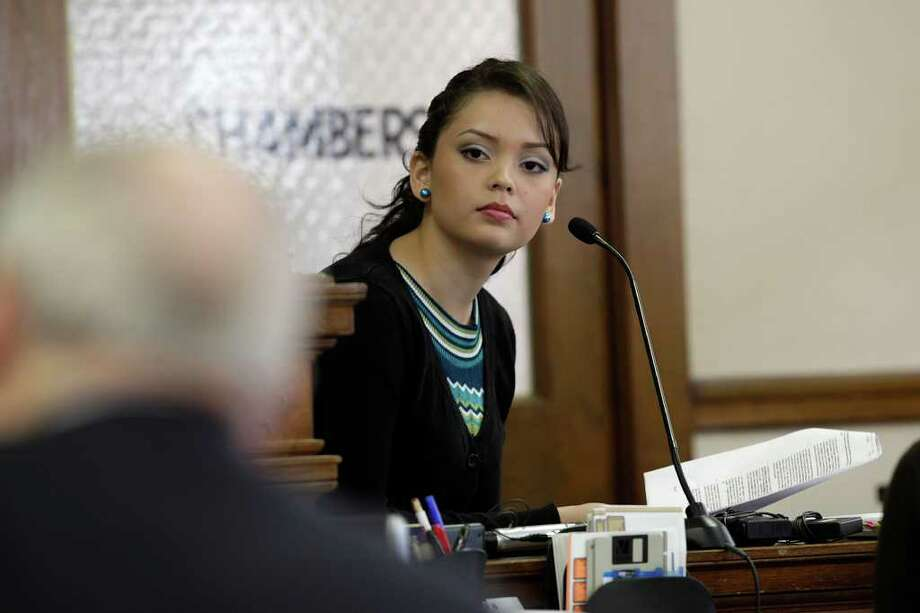 Holding a copy of her Miss San Antonio contract, former Miss San Antonio Domonique Ramirez testifies in the Bexar County 45th District Court on Monday, March 21, 2011. Ramirez is suing the Miss Bexar County Organization, Inc., in an attempt to regain her title. Photo: JERRY LARA, Jerry Lara/Express-News / SAN ANTONIO EXPRESS-NEWS
