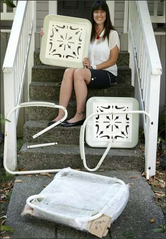 "Mary McMahon used Domystuff.com to hire someone in Maryland to pick up a set of patio furniture she'd bought on eBay, disassemble it and ship it to her home in Seattle. She first contacted a moving company, which quoted her a price of $1,300. But her Domystuff ""employee"" did it for $180 and provided instructions for reassembly. Photo: Joshua Trujillo/Seattle Post-Intelligencer"