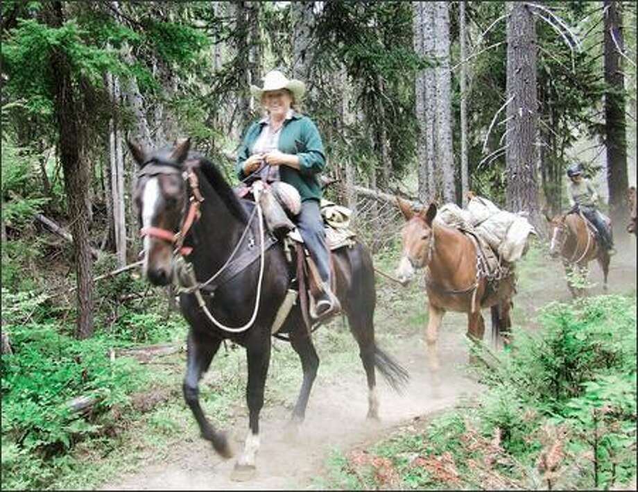 A horse party on the Waptus River Trail stirs up dust -- and a little envy in foot-weary hikers. Photo: Karen Sykes/Special To The Post-Intelligencer