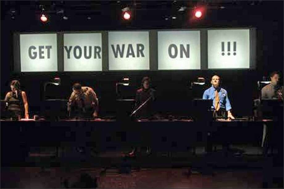 """Rude Mechanicals' play is based on an Internet comic of the same name. Kirk Lynn commands the stage along with the play's title in the opening sequence. """"Get Your War On"""" is among five plays that will be staged at the Center House Theatre. (Jacques-Jean Tiziou) Photo: /"""