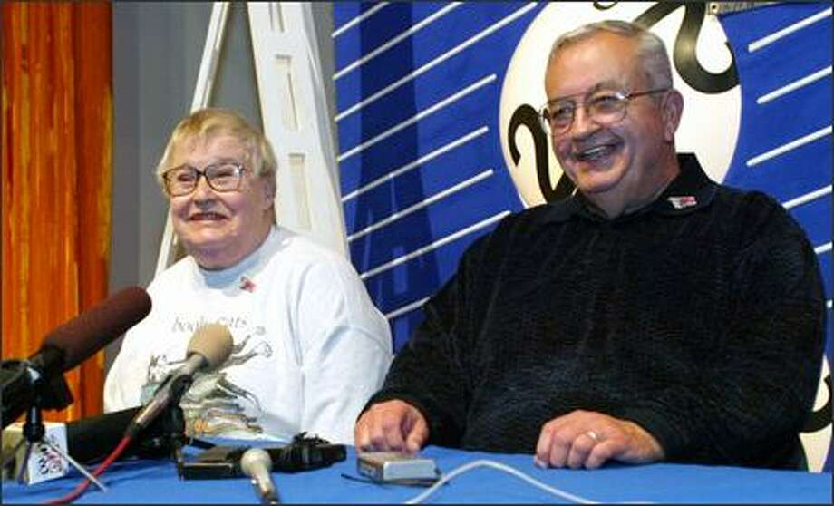 "After winning $40 million after-taxes in 2002, Dick and Patricia Warren of Hoquiam, left, ""put the emphasis on how to give the money away."" Warren says they have given millions away to charities. But they still plan to buy tickets for this week's near-record $330 million Mega Millions jackpot. Photo: / Associated Press"