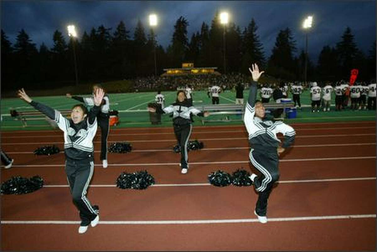 Franklin High cheerleaders try to pump up the fans in Friday night's game against the Redmond Mustangs.