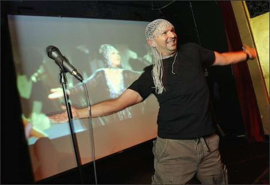 "Philip Heier releases his inner Broadway performer in a rendition of ""Le Jazz Hot"" from ""Victor/Victoria"" during Cineoke! at Rendezvous Restaurant. Photo: Mike Urban/Seattle Post-Intelligencer"