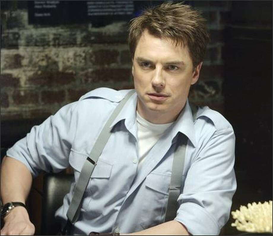 Capt. Jack Harkness (John Barrowman) and his team hunt aliens and collect strange technology. Photo: Adrian Rogers/BBC