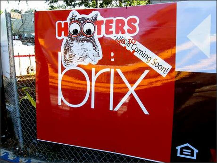 Someone added a Hooters sticker to the Brix project's banner. Photo: ANDREW TAYLOR