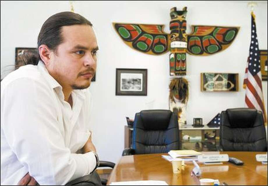 "Micah McCarty is one of five Makah tribal council members headed to Washington, D.C., to talk with lawmakers about the illegal whale hunt. ""Our intent is to assure them we are a law-abiding government,"" he said. Photo: Grant M. Haller/Seattle Post-Intelligencer"