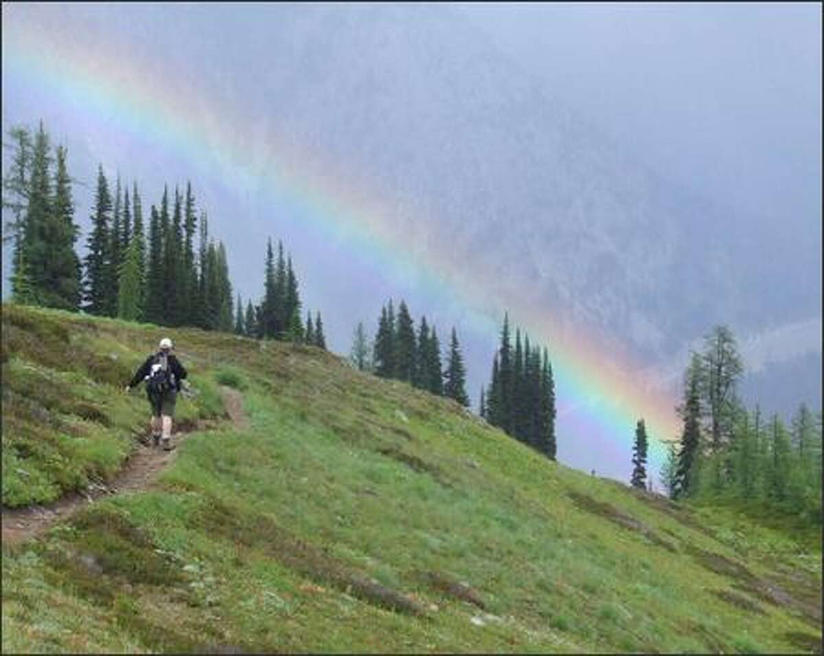 Clouds thwart Steve Payne's hopes of taking in the expansive views near 6,600-foot Maple Pass.