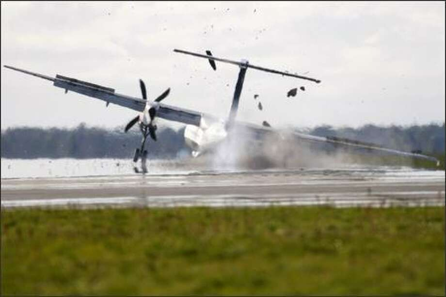 A Scandinavian Airlines Q-400 turboprop makes an emergency landing in Denmark on Sunday, prompting the plane's maker, Bombardier, to call for the grounding of some of the planes. Photo: / Associated Press