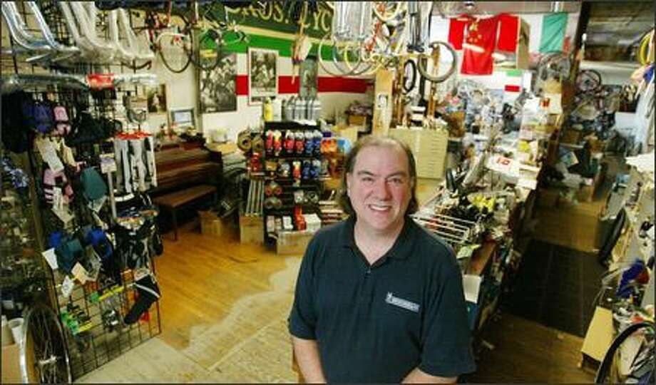 Charles Hadrann owns Wright Bros. Cycle Works in Fremont, which specializes in selling parts and helping customers fix their bikes. Photo: Paul Joseph Brown/Seattle Post-Intelligencer