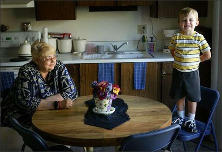 Linda Sorenson hangs out in the kitchen of her Shelton home with one of her grandchildren, Brayden Greenwood, 4. Sorenson, a smoker for 50 years, recently quit for what she hopes is the last time. Photo: Joshua Trujillo/Seattle Post-Intelligencer