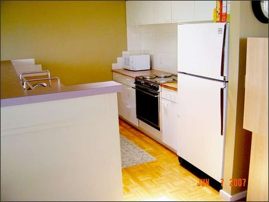 The author and her husband retired their 1980s-style kitchen of white, laminate cupboards and warped, mauve countertops. Photo: /