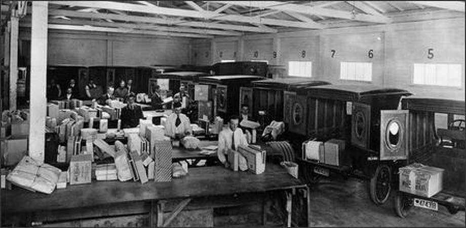 UPS workers sort packages by hand in Oakland, Calif., in 1924. Later that year, in Los Angeles, UPS built the first conveyor belt for parcels. Photo: / United Parcel Service